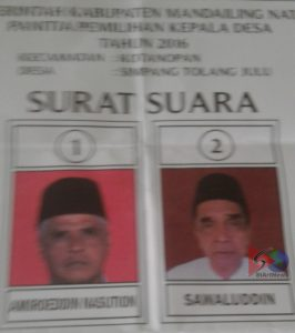 Kertas suara yang gambar calon Kepala Desanya tertukar.